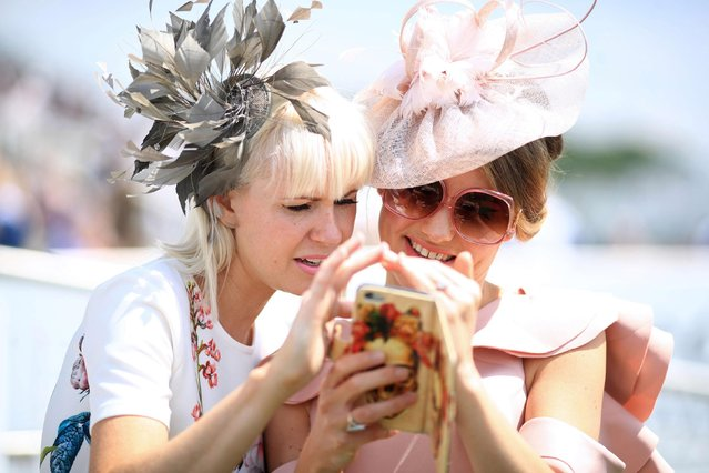 Race goers are pictured during the Investec Ladies Day at Epsom Downs Racecourse on June 2, 2017 in Epsom, England. (Photo by PA Wire)