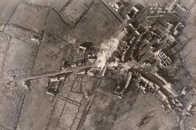 An aerial photograph taken from a British aeroplane shows bomb damage on the Western Front, in this February 16, 1918 handout picture. This picture is part of a previously unpublished set of World War One (WWI) images from a private collection. The pictures offer an unusual view of varied and contrasting aspects of the conflict, from high tech artillery to mobile pigeon lofts, and from officers partying in their headquarters to the grim reality of life and death in the trenches. The year 2014 marks the centenary of the start of the war. (Photo by Reuters/Archive of Modern Conflict London)
