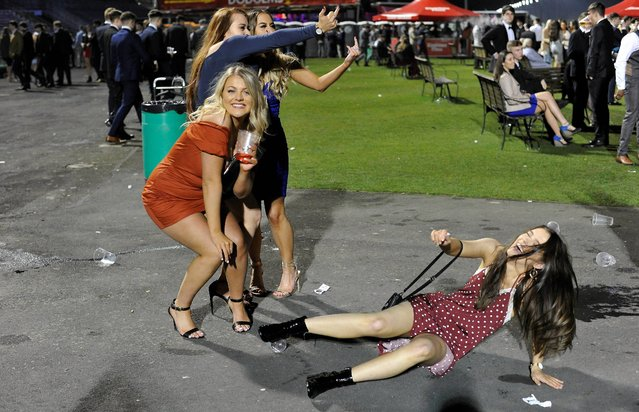 The thousands of students gathered at Newcastle Racecourse near Newcastle upon Tyne, United Kingdom on March 3, 2019 for a booze-filled night of mayhem. The last race ended at approximately 8pm then the grandstand became like a night-club. (Photo by Craig Connor/North News and Pictures)