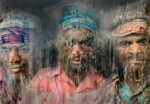 Second Place: Gravel Workmen. Gravel crush working place remains full of dust and sand. Three gravel workmen are looking through the window glass at their working place. Chittagong, Bangladesh. (Photo and caption by Faisal Azim/National Geographic Traveler Photo Contest)