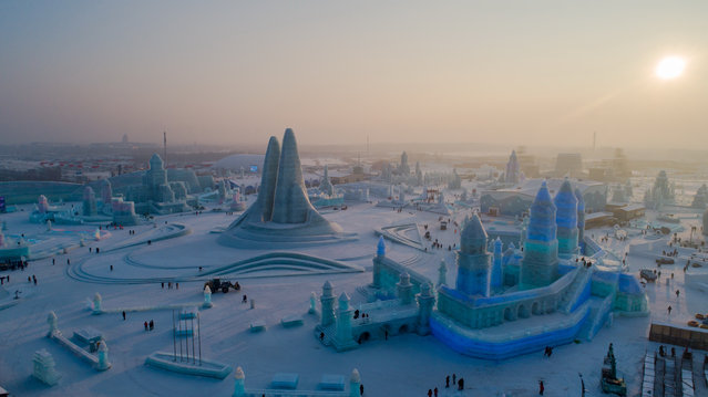 Aerial photo taken on December 23, 2019 shows a view of the 21st Ice-Snow World in Harbin, capital of northeast China's Heilongjiang Province. (Photo by Costfoto/Barcroft Media)