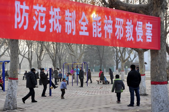 "Part of a propaganda banner which reads, ""Prevent and reject the Church of Almighty God's cult invasions"", is seen at an outdoor exercising court, in Puyang, Henan province, China, in this file picture taken January 12, 2012. The founder of modern China, Mao Zedong, banned fortune telling and superstition in puritan, communist China after the 1949 revolution, but the occult has made a comeback since the still officially atheist country embraced economic reforms and began opening up in the late 1970s. (Photo by Reuters/Stringer)"