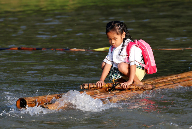 A girl rides on a makeshift raft to attend the opening of classes at a remote Casili Elementary School in Montalban, Rizal northeast of Manila, Philippines June 13, 2016. (Photo by Erik De Castro/Reuters)