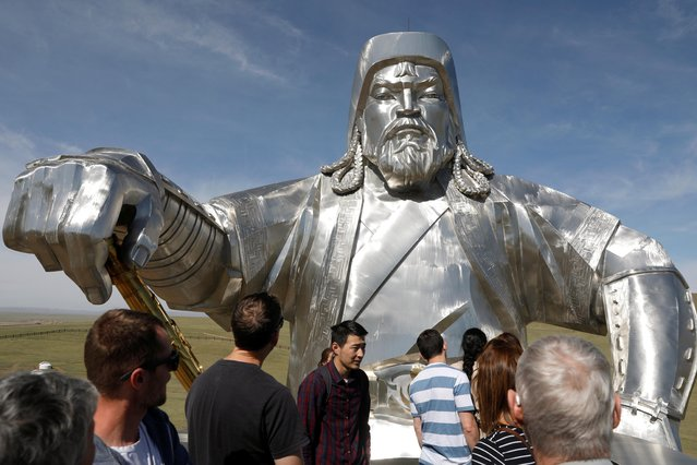 People visit the Genghis Khan Equestrian Statue at the Genghis Khan Statue Complex, east of Ulaanbaatar, Mongolia on June 1, 2019. (Photo by B. Rentsendorj/Reuters)