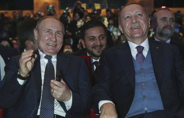 Turkish President Recep Tayyip Erdogan, right, and Russian President Vladimir Putin smile during a ceremony for the dual natural gas line, TurkStream, connecting their countries, in Istanbul, Wednesday, January 8, 2020. Putin and Erdogan inaugurated the natural gas line that will open up a new export path for Russian gas into Turkey and Europe. Erdogan and Putin are also expected to discuss Syria and Libya, where the two leaders support opposing sides, while addressing regional tensions in Iraq and Iran, which have escalated with the American killing of a top Iranian commander. (Photo by Presidential Press Service via AP Photo/Pool)