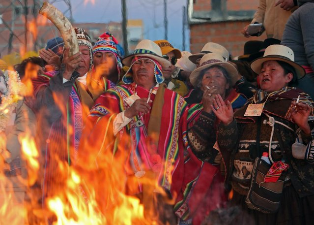 "Local priests celebrate the ""Aimara New Year"", an Andean Bolivian traditional festival that marks the winter solstice in El Alto, Bolivia, 21 June 2016. Aimara or Aymara means the Return of the Sun. (Photo by Martin Alipaz/EPA)"