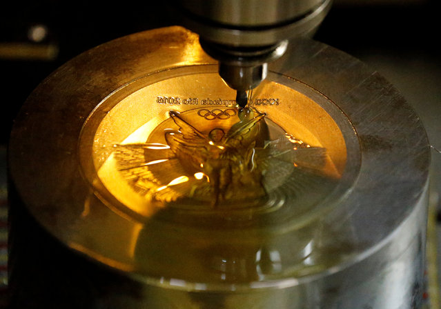 A machine works on a Rio 2016 Olympic medal at the Casa da Moeda do Brasil (Brazilian Mint) in Rio de Janeiro, Brazil, June 28, 2016. (Photo by Sergio Moraes/Reuters)