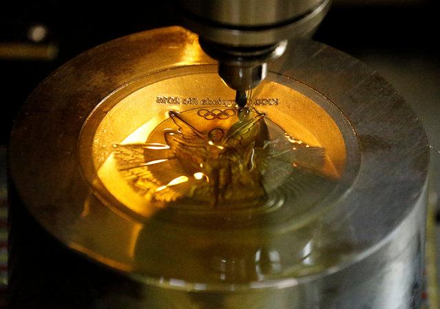 A machine works on a Rio 2016 Olympic medal at the Casa da Moeda do Brasil (Brazilian Mint) in Rio de Janeiro, Brazil, June 28, 2016. (Photo by Sergio Moraes/Reuters)