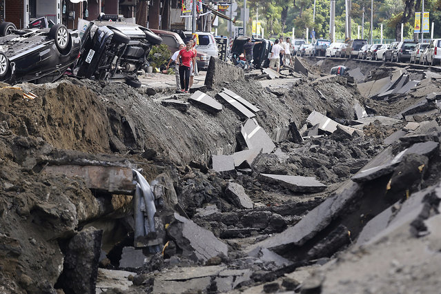 A road is seen after an explosion in Kaohsiung, southern Taiwan, August 1, 2014. The explosion caused by a gas leak in Taiwan's second city killed 22 people, injured 270 and sent flames shooting 15 storeys into the air, a government agency said. (Photo by Toby Chang/Reuters)
