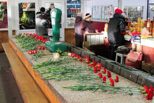 Flowers in memory of Vadim Yangolenko and Darya Yefimova, husband and wife, shot dead at Kaliningrad's Central Market in Kaliningrad, Russia on February 16, 2020. On February 15, 2020, 63-year-old Fazil Bakhramov opened fire at an entrance to the market, killed the husband and wife and inured their 13-year-old son. After the attack the shooter committed suicide. (Photo by Alexander Arkhipov/TASS)