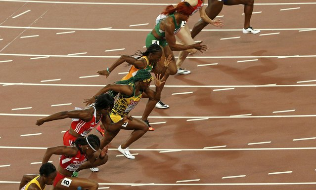 Athletes compete in the women's 100 metres semi-final during 15th IAAF World Championships at the National Stadium in Beijing, China August 24, 2015. (Photo by Kim Kyung-Hoon/Reuters)