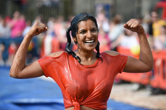 """Roxy Afzal, wrestling under the name """"The Oxo Fox"""", celebrates being crowned the Womens 10 th annual World Gravy Wrestling Champion at the Rose 'n' Bowl Pub near Bacup, north west England on August 28, 2017. (Photo by Oli Scarff/AFP Photo)"""