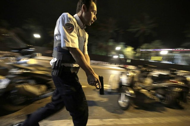 A police officer runs on the street where dozens of people died and more were injured after a truck plowed into pedestrians during Bastille Day celebrations in Nice, France on July 14, 2016. (Photo by Franck Fernandes/Maxppp via ZUMA Press)