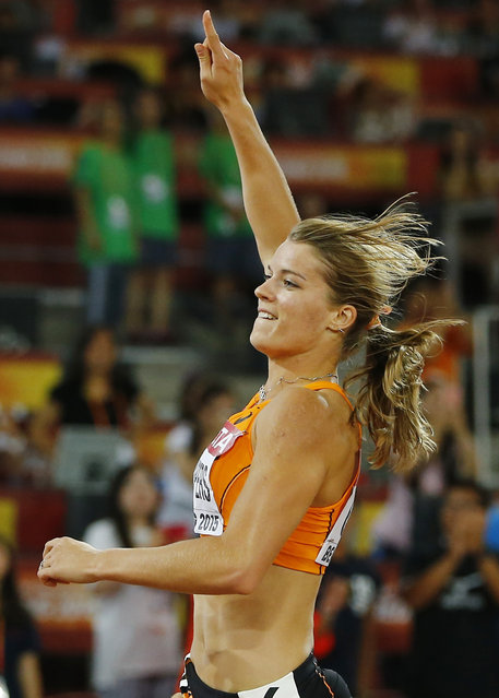 Dafne Schippers of Netherlands celebrates winning the women's 200 metres final during the 15th IAAF World Championships at the National Stadium in Beijing, China August 28, 2015. (Photo by Kai Pfaffenbach/Reuters)