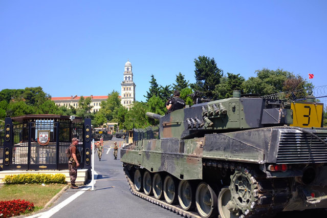 Police officers drive some of the tanks that were used by soldiers participating in the attempted coup, back to the Selimiye Army Base in Istanbul, Saturday, July 16, 2016. Turkish President Recep Tayyip Erdogan told the nation Saturday that his government was working to crush a coup attempt after a night of explosions, air battles and gunfire across the capital that left dozens dead and scores wounded. (Photo by Cansu Alkaya/AP Photo)