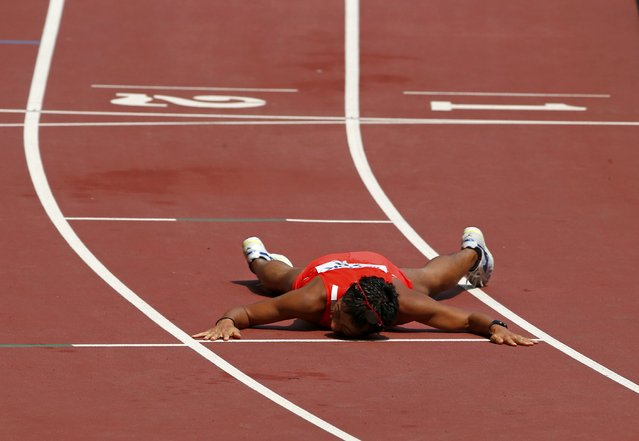 Takayuki Tanii of Japan lies on the floor after finishing third in the men's 50 km race walk final during the 15th IAAF World Championships at the National Stadium in Beijing, China August 29, 2015. (Photo by David Gray/Reuters)