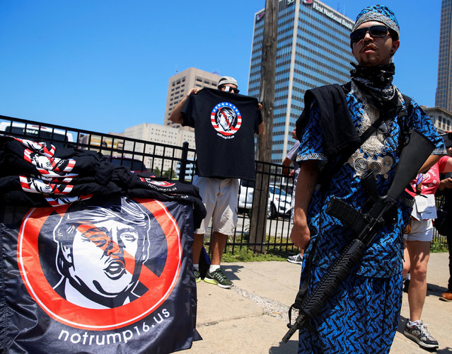 James Campbell exercises his right to open carry holding a military style semi-automatic rifle near public square outside the Republican National Convention in Cleveland, Ohio, U.S. July 19, 2016. (Photo by Shannon Stapleton/Reuters)
