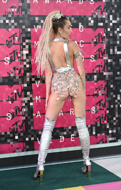 Miley Cyrus arrives at the MTV Video Music Awards at the Microsoft Theater on Sunday, August 30, 2015, in Los Angeles. (Photo by Jordan Strauss/Invision/AP Photo)