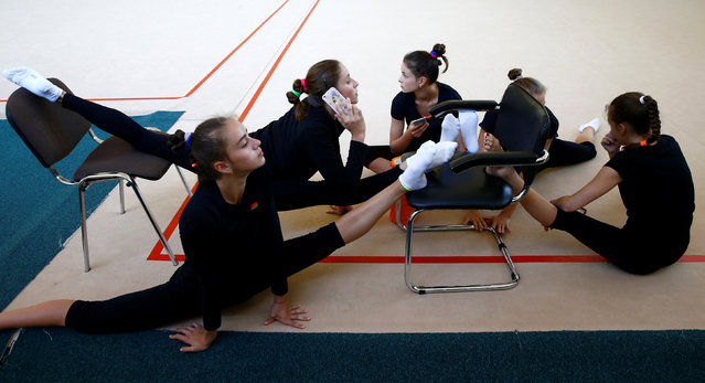 Members of the Belarussian rhythmic gymnastics team stretch during a training session at a sports base as they prepare for the 2016 Rio Olympics in Minsk, June 28, 2016. (Photo by Vasily Fedosenko/Reuters)