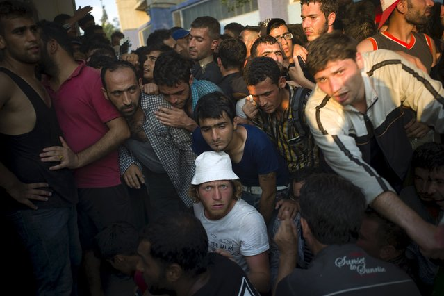 Migrants crowd around as they line up for a registration procedure at the port of Mytilene on the Greek island of Lesbos, September 3, 2015. (Photo by Dimitris Michalakis/Reuters)