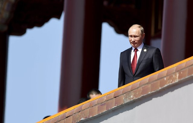 Russia's President Vladimir Putin is seen on the Tiananmen Gate, at the beginning of the military parade marking the 70th anniversary of the end of World War Two, in Beijing, China, September 3, 2015. (Photo by Reuters/Stringer)