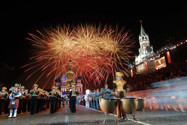 """Fireworks explode above Saint-Basil's cathedral during the first day of the International Military Music Festival """"Spasskaya Tower"""" in Red Square in Moscow August 30, 2014. (Photo by Maxim Zmeyev/Reuters)"""