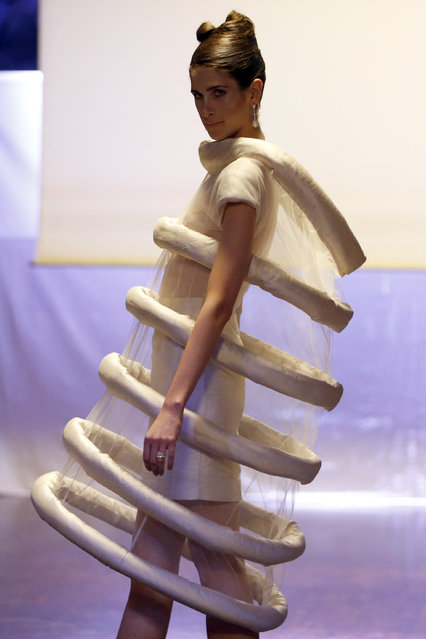 A model presents a creation by American-born UK-based designer Corrie Nielsen as part of her Spring/Summer 2015 women's ready-to-wear collection during Paris Fashion Week September 23, 2014. (Photo by Charles Platiau/Reuters)