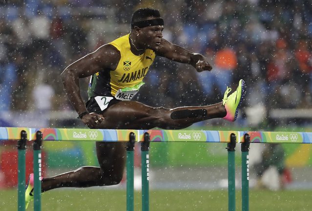 Jamaica's Omar Mcleod competes in a men's 110-meter hurdles heat during the athletics competitions of the 2016 Summer Olympics at the Olympic stadium in Rio de Janeiro, Brazil, Monday, August 15, 2016. (Photo by Natacha Pisarenko/AP Photo)