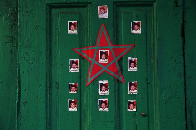 Stickers with pictures of Moroccan King Mohammed VI decorate doors in national colours in Rabat's Medina September 22, 2014. (Photo by Damir Sagolj/Reuters)