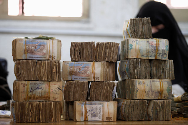 Piles of Yemeni currency are pictured at the Central Bank of Yemen in Sanaa August 24, 2016. (Photo by Khaled Abdullah/Reuters)