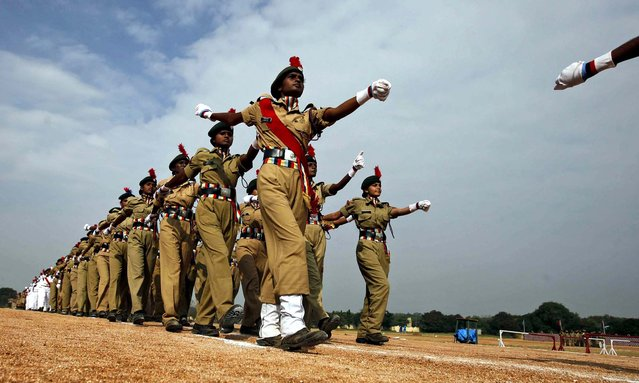 National Cadet Corps cadets march during a parade to mark the anniversary of the NCC in Hyderabad, India,  November 22, 2012. NCC is a tri-services organization comprising the Army, Navy and Air Force, engaged in grooming youth into disciplined and patriotic citizens. (Photo by Mahesh Kumar/Associated Press)