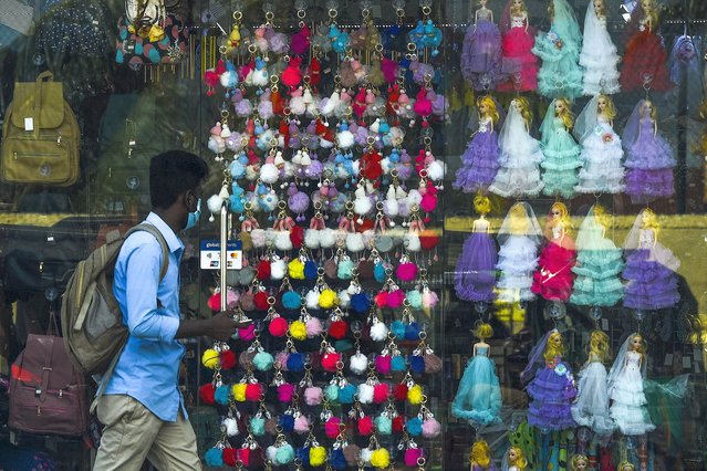 A man walks past a toys shop in Colombo on July 23, 2020. (Photo by Ishara S. Kodikara/AFP Photo)