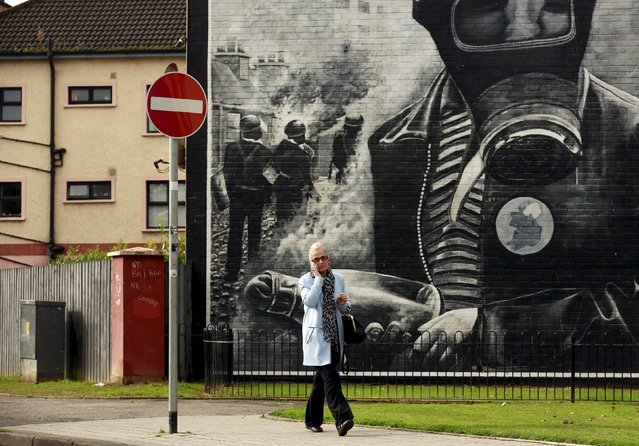A woman walks past graffiti in the Bogside area of Londonderry in Northern Ireland, September 25, 2015. (Photo by Cathal McNaughton/Reuters)