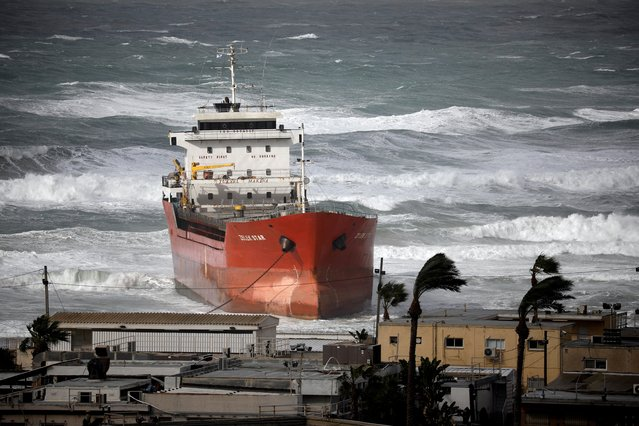 A cargo vessel that arrive at Israel's Ashdod port and was swept away when a storm began is seen close to the beach in the Mediterranean Sea close to Ashdod's port in southern Israel on December 26, 2019. (Photo by Amir Cohen/Reuters)