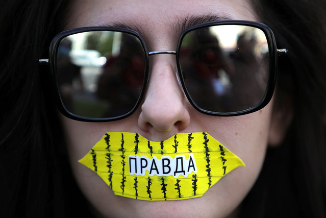"""A student takes part in a protest in Minsk, Belarus on September 1, 2020. The announcement of the results of the 2020 Belarusian presidential election has sparked mass protests in Minsk and major cities across Belarus. A sticker reads """"Truth"""". (Photo by Sergei Bobylev/TASS)"""
