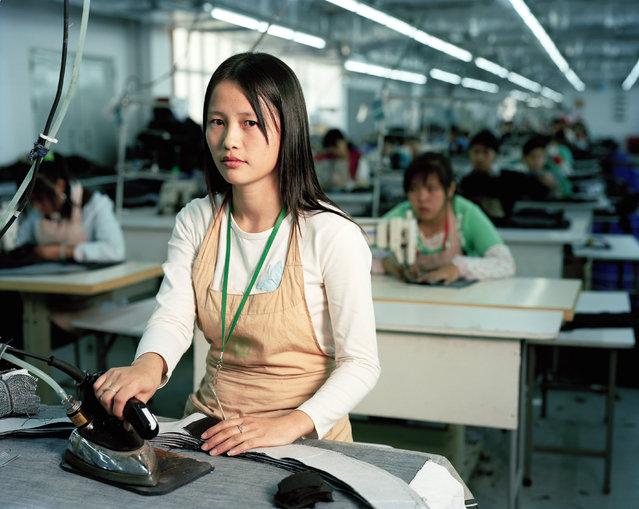 Liu Baozhu (25), Worker at textile factory. Nanshui, Guangdong. (Photo by Mathias Braschler and Monika Fischer)