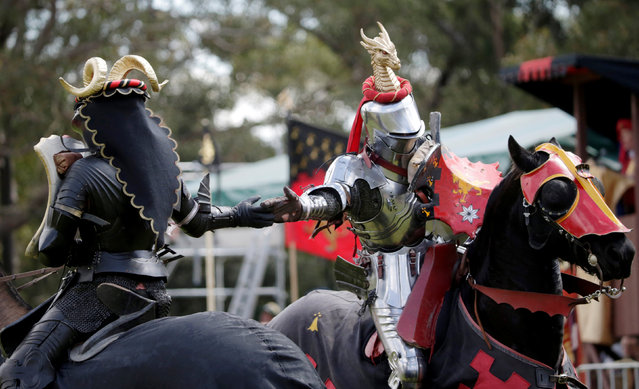 Australian jouster Philip Leitch (R) wears a dragon on his helmet as he shakes hands with competitor Simon Tennant during a jousting tournament at the St Ives Medieval Fair in Sydney, one of the largest of its kind in Australia, September 24, 2016. (Photo by Jason Reed/Reuters)