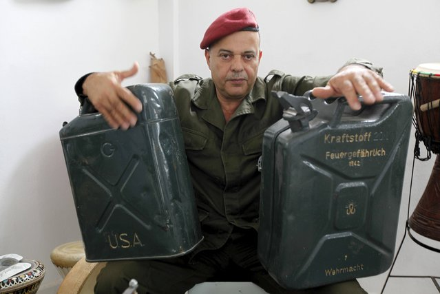 Tunisian Army retiree Belgacem Majri plays music using homemade musical instruments that he built using arms such as bombs and missiles, in Tunis, Tunisia October 20, 2015. (Photo by Anis Mili/Reuters)