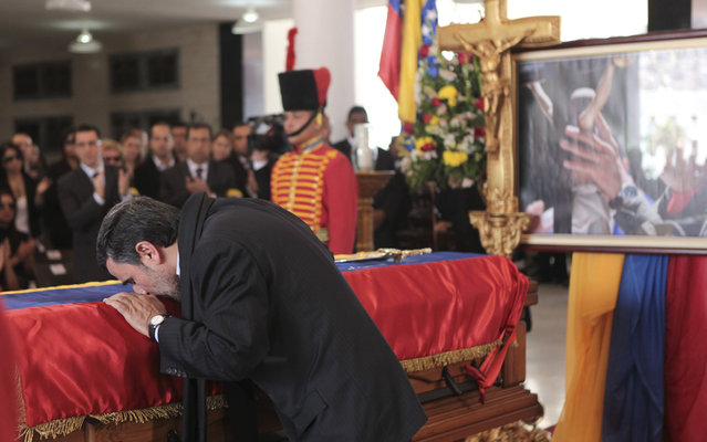 "Iran's President Mahmoud Ahmadinejad pays tribute to late Venezuelan President Hugo Chavez, during the funeral service at the Military Academy in Caracas March 8, 2013, in this picture provided by the Miraflores Palace. Chavez will be embalmed and put on display ""for eternity"" at a military museum after a state funeral and an extended period of lying in state, acting President Nicolas Maduro said on Thursday. (Photo by Miraflores Palace/Reuters)"