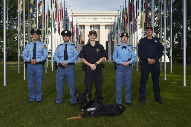 "Members of the United Nations security forces pose in front of the U.N. European headquarters in Geneva October 20, 2014. U.N. police in Geneva follow the local cantonal police rules, which say that ""the use of weapons, proportionate to the circumstances, is authorised as a last resort"" but should ""avoid serious injury whenever possible"", and that ""the use of a firearm is preceded by a warning – if circumstances permit"". The United Nations Office in Geneva is considered ex-territorial and is not under the jurisdiction of the host country Switzerland. (Photo by Denis Balibouse/Reuters)"