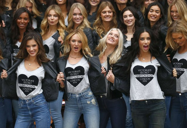 Models pose for a group photograph outside the Victoria's Secret shop on New Bond Street in central London, December 1, 2014. The 2014 Victoria's Secret Fashion Show will be held in London on Tuesday. (Photo by Andrew Winning/Reuters)