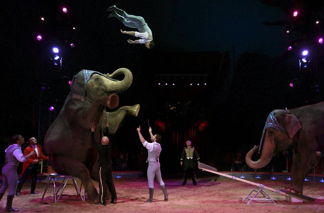 Acrobats perform with elephants during a rehearsal for the new show of Swiss National-Circus Knie in the town of Rapperswil east of Zurich March 21, 2013. Circus Knie starts its nationawide tour 2013 later today. (Photo by Arnd Wiegmann/Reuters)