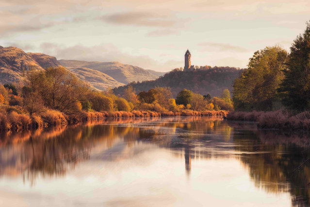"Wallace monument from the banks of the Forth, Stirlingshire. Historic Britain special award winner. ""The Wallace monument taken from the backs of the River Forth on a calm autumn morning. I had been to this location on many previous occasions to take a sunrise image and again on this morning I thought I was going to be disappointed. Although the sunrise was underwhelming, something made me wait for an extra few hours to see what would happen with the light"". (Photo by Graham MacKay/UK Landscape Photographer of the Year 2020)"