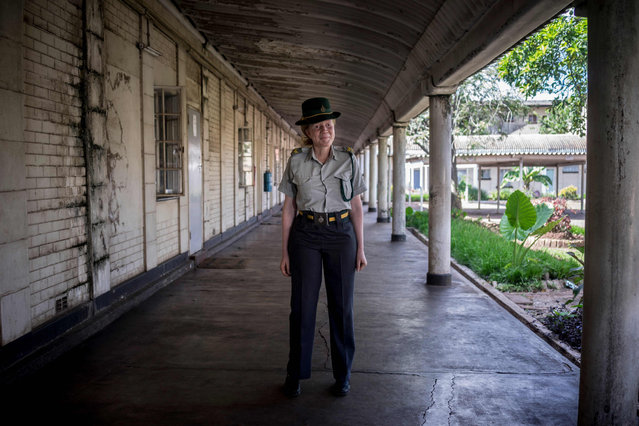 First Albino female prisons officer Nomatter Mashaire, (32), stands in a corridor at the Zimbabwe Prisons and Correctional Services (ZPCS) headquarters on 22 February 2018 in Harare, Zimbabwe. (Photo by Zinyange Auntony/AFP Photo)