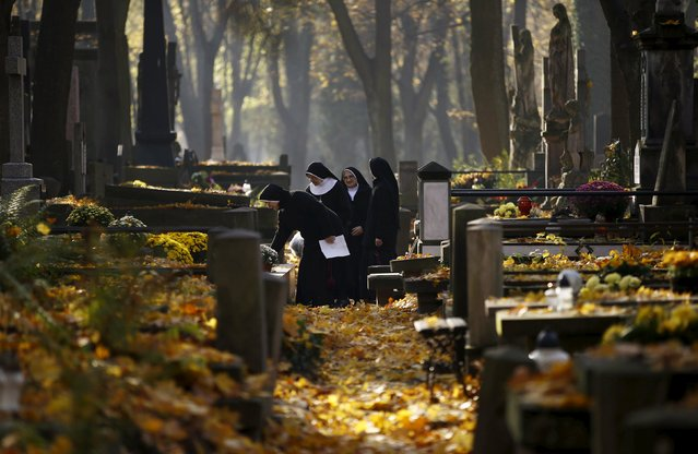 Nuns stand near a grave as they visit the Powazki cemetery during All Saints Day in Warsaw, Poland November 1, 2015. (Photo by Kacper Pempel/Reuters)