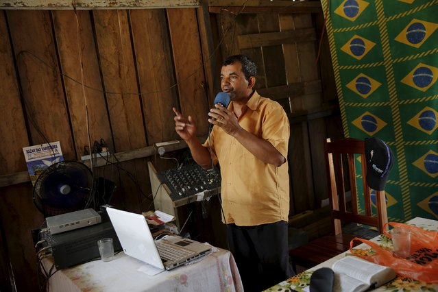 Isolino, 58, speaks on an evangelical radio station in Rio Pardo next to Bom Futuro National Forest, in the district of Porto Velho, Rondonia State, Brazil, August 31, 2015. (Photo by Nacho Doce/Reuters)