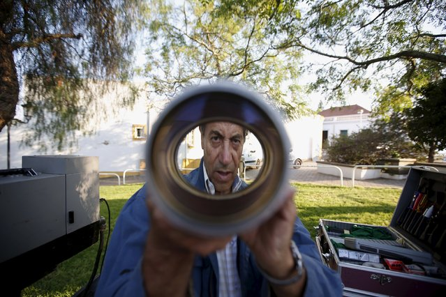 Projectionist Antonio Feliciano, 75, checks the lens of his projector in Castro Verde, Portugal August 31, 2013. (Photo by Rafael Marchante/Reuters)