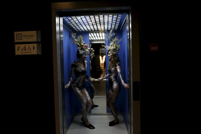Models wearing creations by Luis Benitez are seen in an elevator during an urban shoot as part of Andalucia de Moda (Andalusia Fashion) at the aquarium of Seville, southern Spain, November 11, 2015. (Photo by Marcelo del Pozo/Reuters)