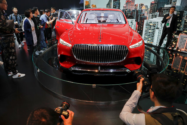 People check Mercedes-Maybach Ultimate Luxury during a media preview at the Auto China 2018 motor show in Beijing, China on April 25, 2018. (Photo by Damir Sagolj/Reuters)