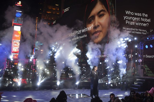 Singer Idina Menzel performs as an image of schoolgirl activist Malala Yousafzai is projected on a screen in Times Square on New Year's Eve in New York December 31, 2014. (Photo by Carlo Allegri/Reuters)